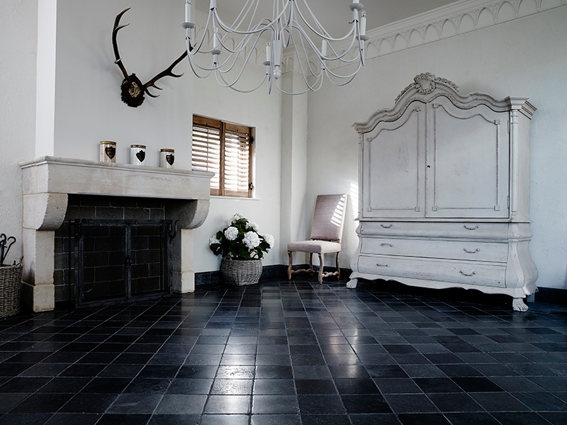 Stone specialist Lapicida uses everything from classic limestone and antique reclaimed stone to porcelain and ceramics. Its Belgian Mixed Distressed limestone tile displays shades of deep black, blue-black, and black-grey.