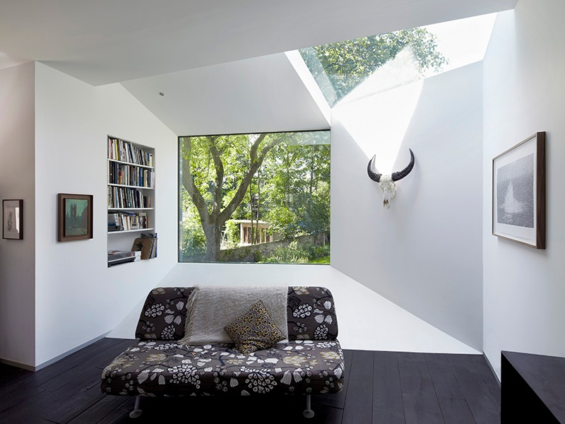 The trapezoid-shaped extensions of Lens House pull in light and frame the garden views. Photograph: Paul Riddle