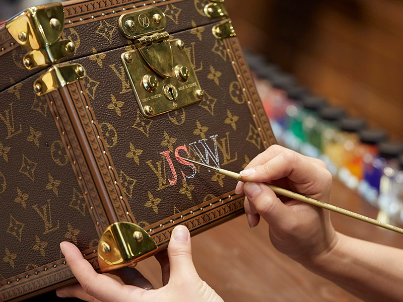 Louis Vuitton's trunks, such as this one in the Monogram canvas, can be personalized with initials or your choice of design—all hand-painted.