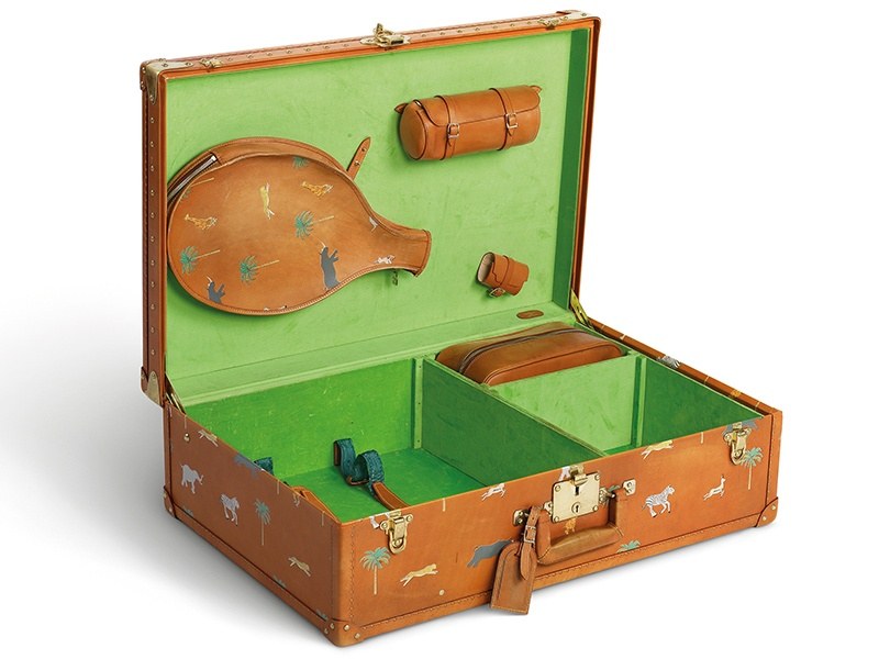This calf-leather Louis Vuitton Alzer suitcase was created by Marc Jacobs in 2007 especially for Wes Anderson's movie <i>The Darjeeling Limited</i>.