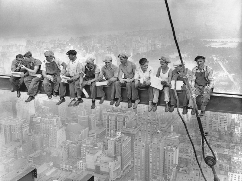 """The famous photograph <i>Lunch atop a Skyscraper</i> was taken on the steelworks of Rockefeller Center in 1932, more than 800 feet above Manhattan. The image was later described by <i>TIME</i> magazine as a """"symbol of American resilience and ambition at a time when both were desperately needed."""" Photograph: Getty Images"""