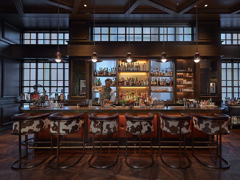 An intimate speakeasy, The Office NYC serves classically inspired food and cocktails, a collection of vintage spirits, and other eclectic delicacies.