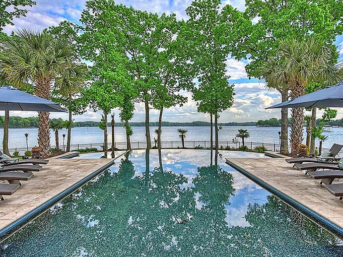 The standout feature of the property is arguably its infinity saltwater pool, which stretches out towards the lake. Photograph: Ivester Jackson