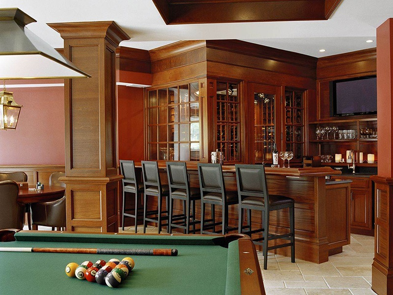 The seven-bedroom home also boasts a wine cellar and bar, billiards room, exercise room, sauna, theater, and playroom.
