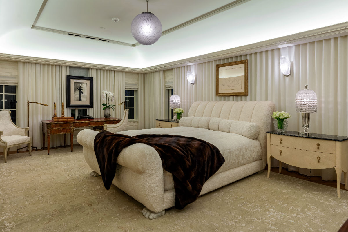 The upstairs master bedroom is a study in subtle Deco influences.