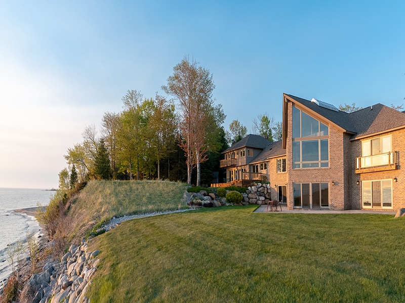 Overlooking 303 feet (92 m) of Lake Michigan waterfront, this six-bedroom luxury estate is surrounded by nature, set among 19 wooded acres (8 ha). It boasts grand living and dining areas with vaulted ceilings, and a stunning terrace from which to survey the landscape.