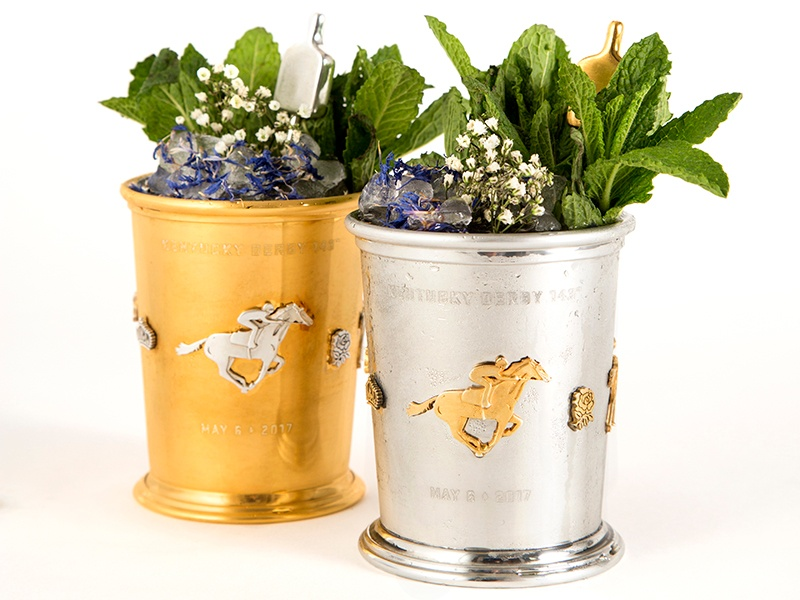 The mint julep has been the traditional beverage of the Kentucky Derby for nearly a century. Woodford Reserve's commemorative cups for the 2017 event are handcrafted by Louisville-based jeweler From the Vault.