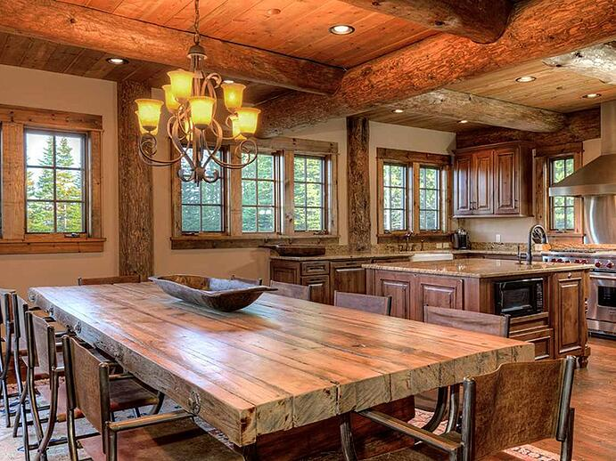 Extensive log details and other wood accents create a sylvan yet elegant feel in the kitchen. Photograph: PureWest Real Estate