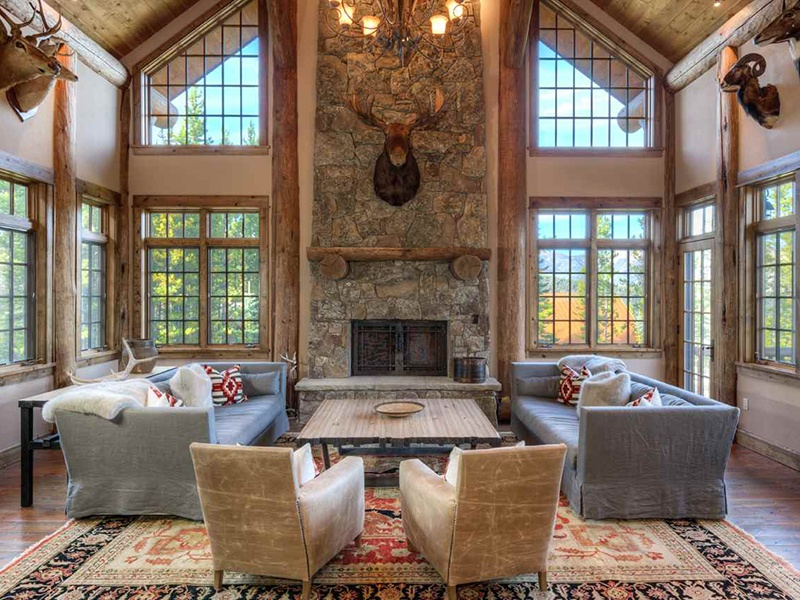 Stunning high ceilings and a grand stone fireplace distinguish the main living area of the property. Photograph: PureWest Real Estate