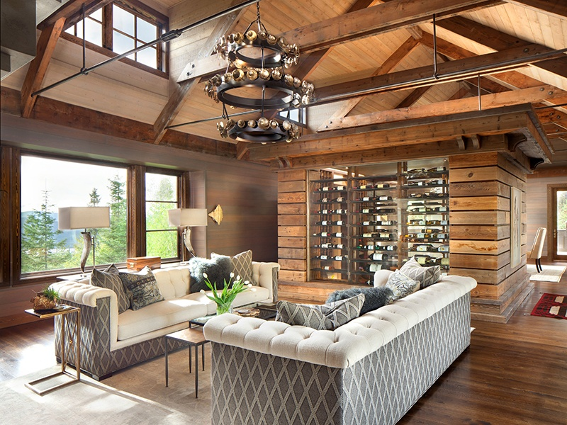 The light-filled living room features an impressive limestone fireplace, while the vaulted ceiling consists of wooden beams reclaimed from a whisky distillery. Photograph: PureWest Real Estate
