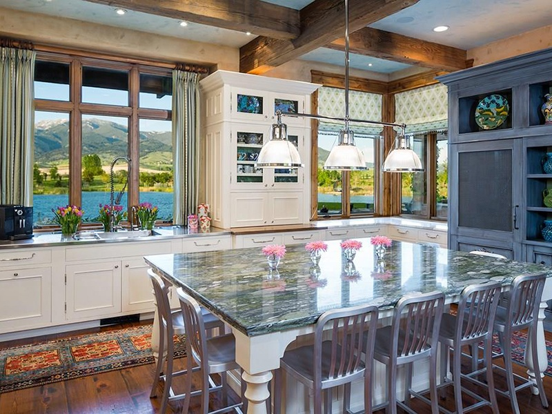 The country-style kitchen comes complete with modern appliances and views of the pond on the property. Photograph: PureWest Real Estate