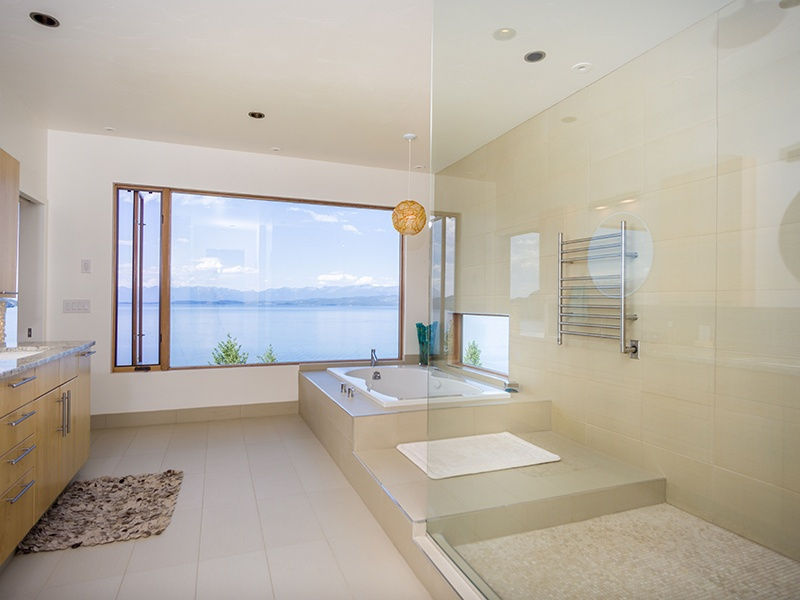 Generously sized rooms offer lake vistas, as do the property's spacious terraces, including a rooftop deck with hot tub. Photograph: PureWest Real Estate