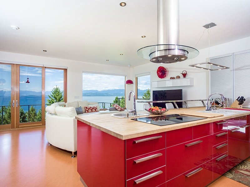 There are panoramic views of the lake from the sleek and modern kitchen. This home comes with 600 feet of shared lake frontage, two boat slips, and a boat lift. Photograph: PureWest Real Estate