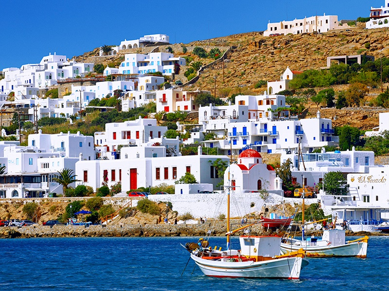 The beautifully minimalist architecture of the Cycladic Islands—flat roofs, cubic shapes, and whitewashed walls—developed naturally over centuries. Photograph and banner image: Getty Images