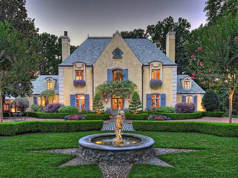 Nestled among immaculately manicured gardens and situated on 5 acres (2 ha) of woodland, this beautiful French country estate-style property in Charlotte, North Carolina, features hand-painted frescos, stunning masonry throughout, a private sun terrace, a wine cellar, and a separate guest house.