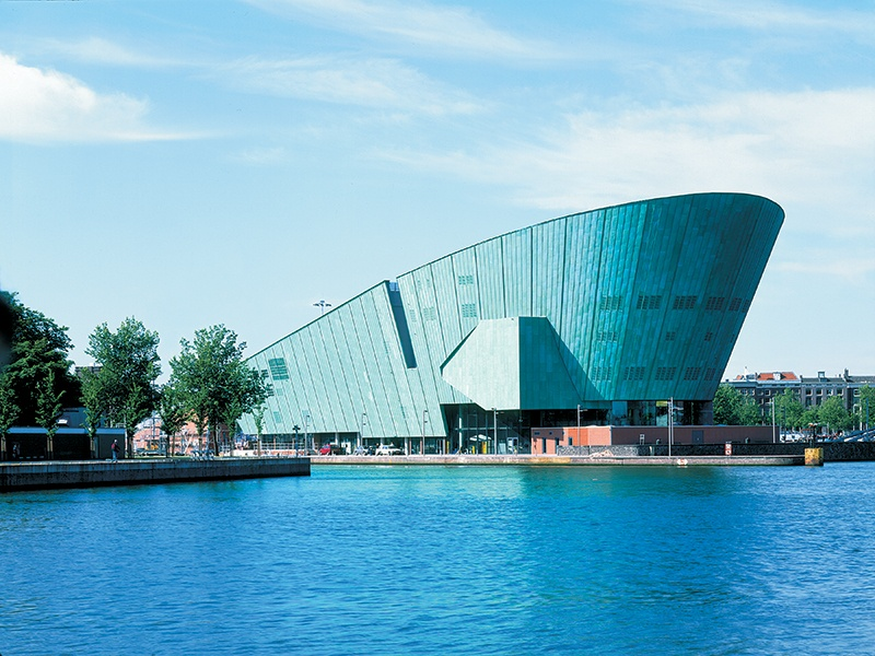 Renzo Piano's 1997 NEMO Science Museum cuts a formidable figure against the backdrop of the Oosterdok. Photograph: Michel Denancé