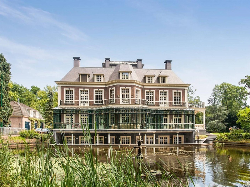 Though it may look charmingly historic, this property near Amsterdam in the Netherlands is thoroughly modern. Constructed in 2012, it has a subterranean swimming pool and a fully equipped bar and wellness area.