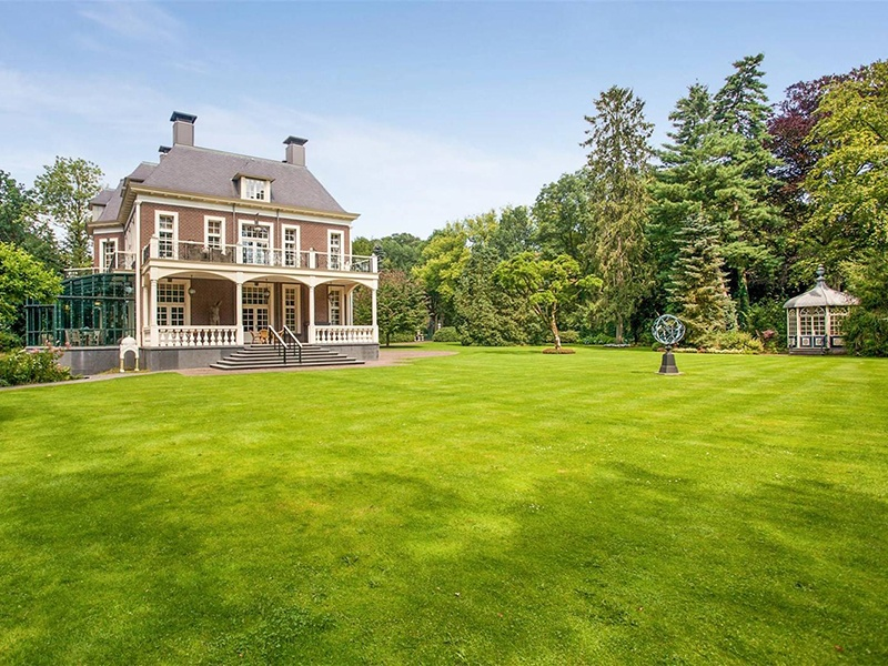 The eight-bedroom home is surrounded by forest, meadows, and parkland.