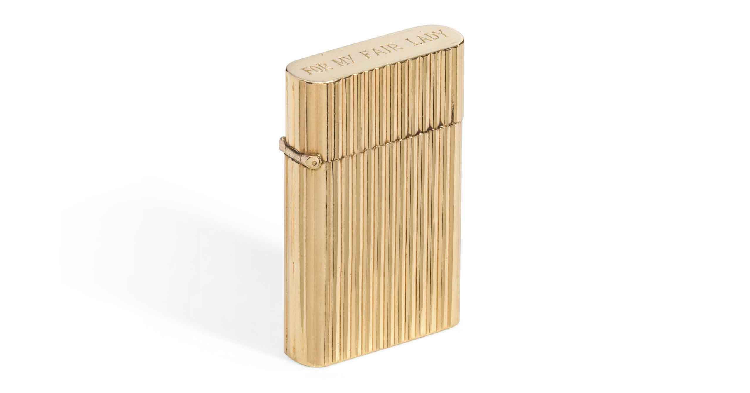 <b>MY FAIR LADY, 1964/GENE ALLEN</br>A CIGARETTE LIGHTER</b></br> Of shaped rectangular form with reeded decoration, the lid with presentation inscription FOR MY FAIR LADY the base engraved GENE ALLEN December 1963</br>2 in. (5 cm.) long</br> Estimate: £3,000-5,000