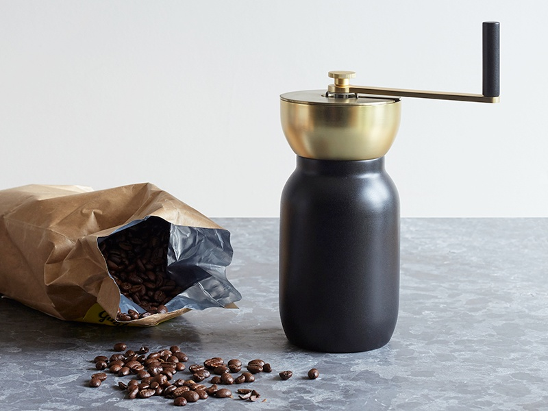 In coated stainless steel with brass accents, the Collar coffee grinder was designed by Italian duo Daniel Debiasi and Federico Sandri for Danish design brand Stelton.