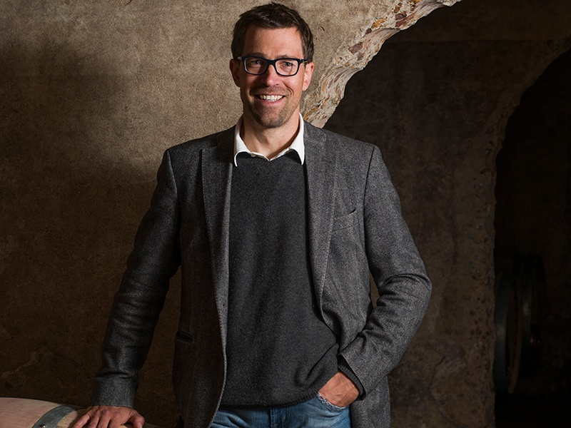 4G Wines founder and CEO Philipp Axt. Banner image: Comprising just 54 acres, De Toren's vineyards are uniquely situated on the Polkadraai Hills, overlooking Stellenbosch.
