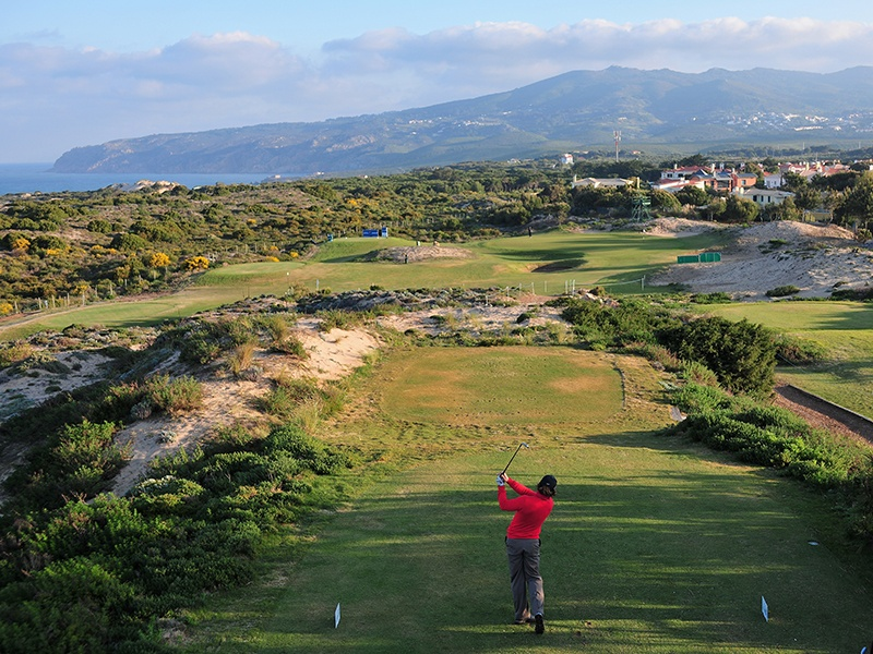 On a plot of land formerly composed of sand dunes and pine forests, Oitavos is one of Europe's most spectacular courses. Respected golf course architect Arthur Hills carved out pristine greens and challenging bunkers amid rugged coastal scenery, with the Sintra Mountains as a backdrop. Photograph: Getty Images