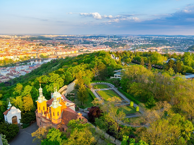 Petřín Hill—the most extensive green space in the city—features an expansive rose garden, a terraced garden, and an observation tower inspired by the Eiffel Tower. Photograph: Getty Images
