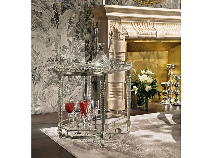 Provasi's timeless and elegant drinks trolley is made from silver brass, with a crystal top.
