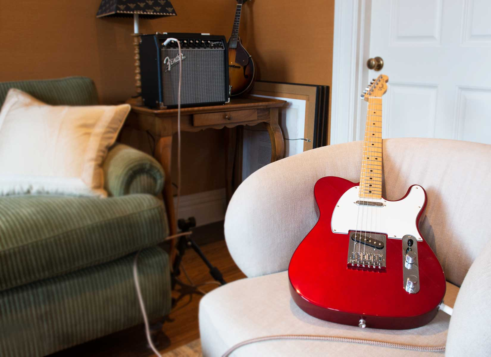 An electric guitar and Fender amplifier in the living room hark back to the heyday of the Harlem Renaissance.