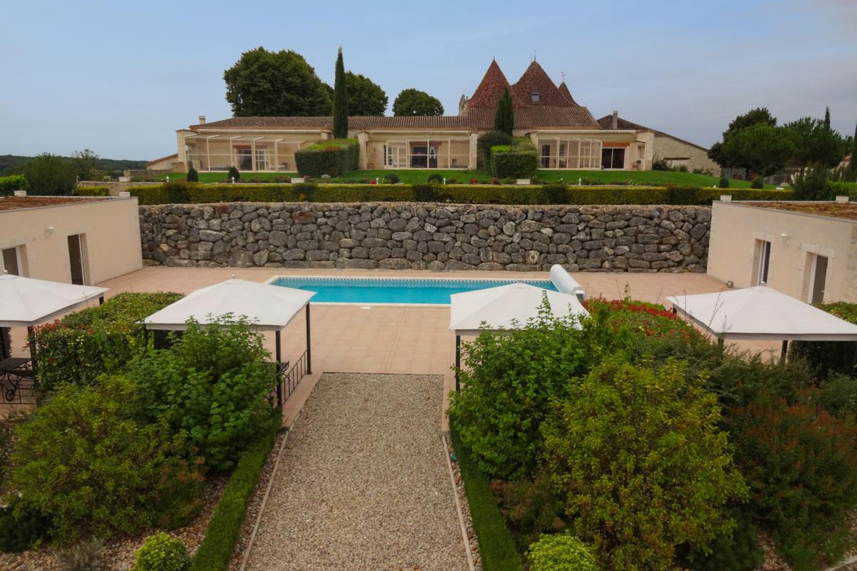 The château has three attached guest quarters all finished to the same high standard, with views over the pool complex and gardens. The heated pool has an automated security cover, and is set alongside a changing room with summer bar, massage room, and an entertainment area, ideal as a spacious tasting room.
