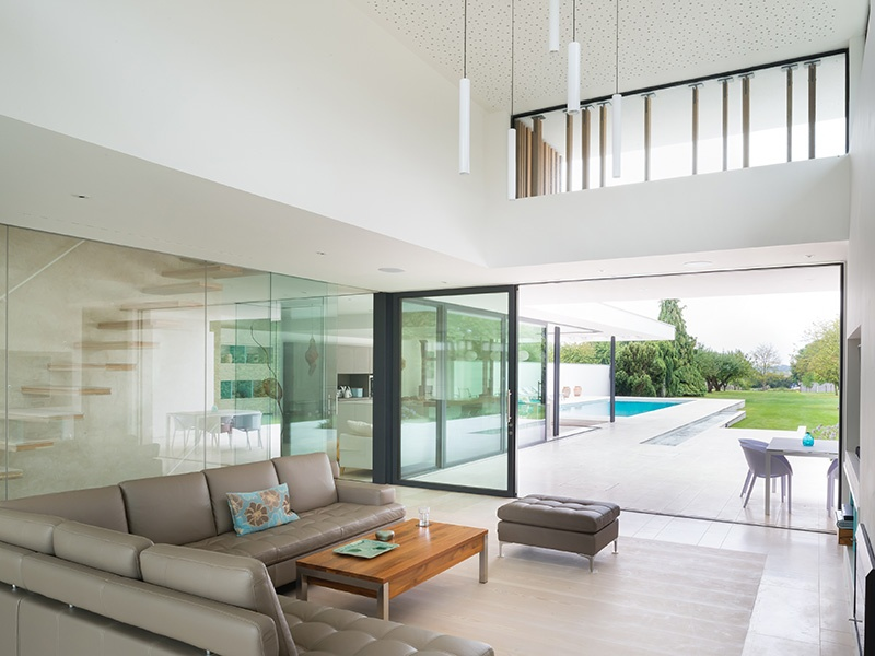 The glass-fronted living space of River House bathes the interiors in soft light. Photograph: Jim Stephenson