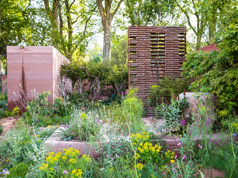 Sarah Price used sustainable building methods in her Chelsea Flower Show 2018 garden, creating rammed-earth walls, with materials dug directly from the earth. Photograph: Claire Takacs