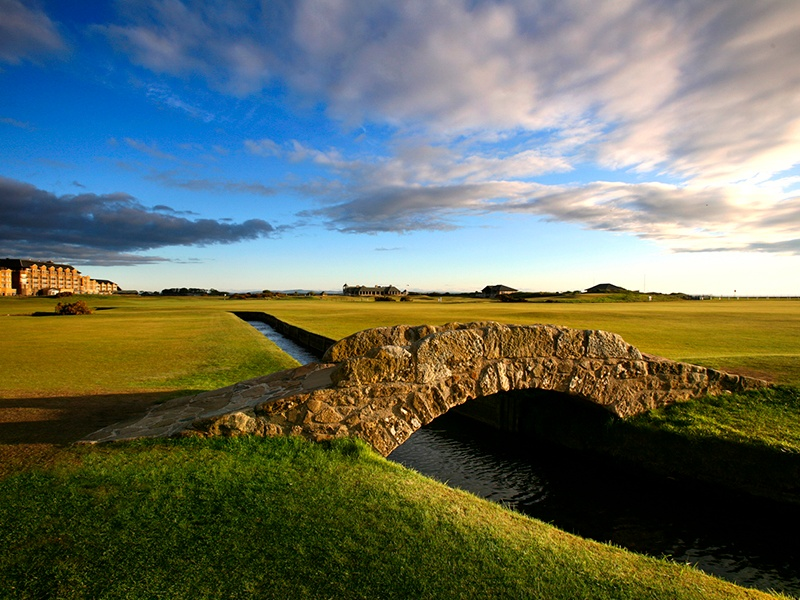 """""""The Home of Golf,"""" St Andrews boasts 600 years of history, with the Old Course home to the iconic Swilcan Bridge and Hell Bunker."""