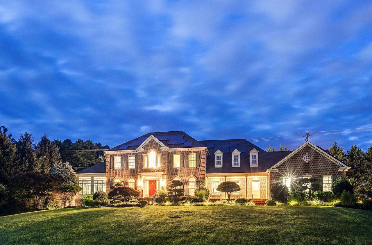 This grand colonial-style manor in Baltimore County, Maryland, blends classic architectural details with resort-inspired amenities and sustainable features, including a whole-house generator and solar power.