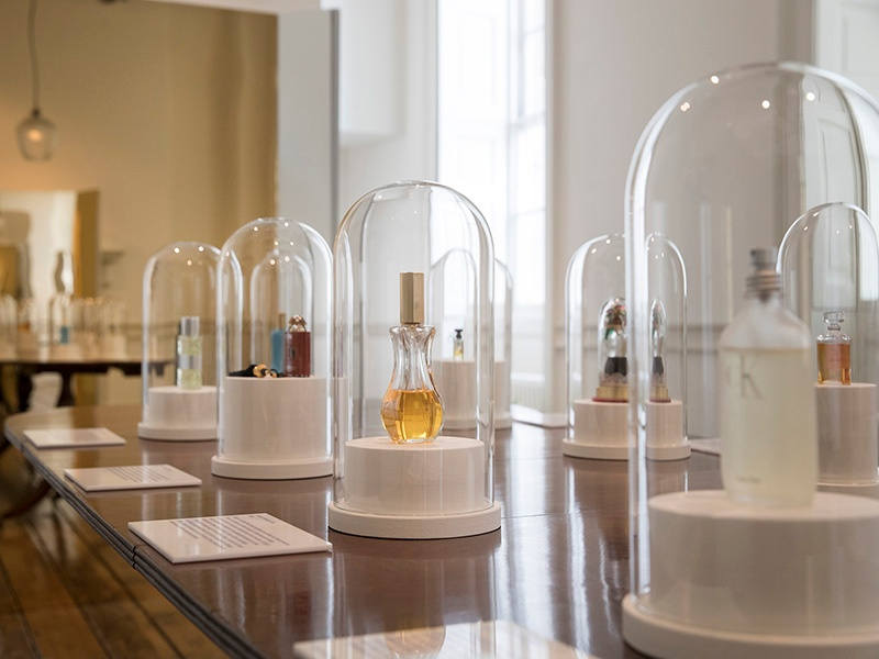 """Visitors to <i>Perfume: A Sensory Journey Through Contemporary Scent</i> will explore a series of rooms that reflect the inspiration behind fragrances made by """"perfume pioneers."""" The exhibition also highlights ten trailblazing scents, beginning with L'Origan de Coty (1905) and ending with ck one (1994). Photograph: Peter MacDiarmid. Banner image: Han's fragrances are associated with limited-edition numbered art prints inspired by the perfume."""