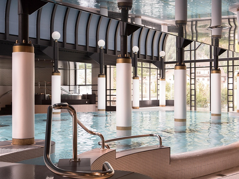 Reminiscent of the bathing culture of Roman times, the spa at the Victoria-Jungfrau Grand Hotel & Spa in Interlaken, Switzerland, includes a large and elegant indoor pool.