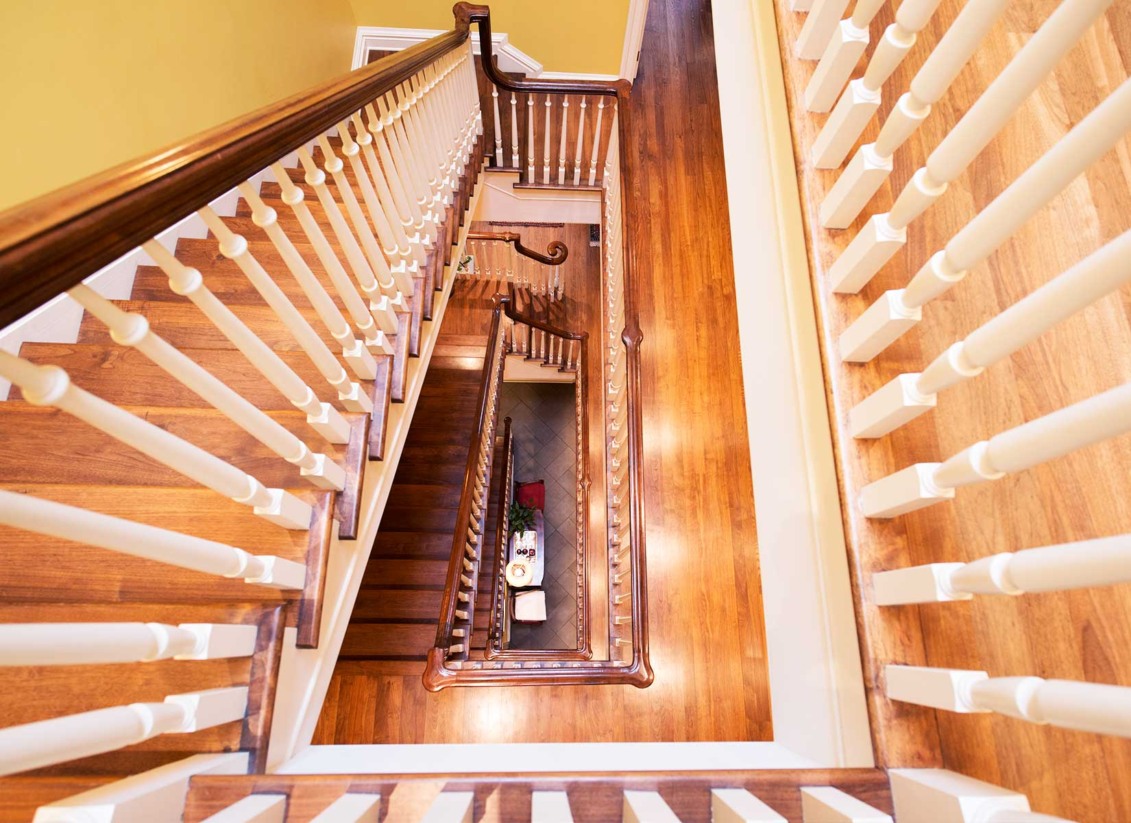 The home's four luxurious levels are accessible via elevator or the grand central staircase.