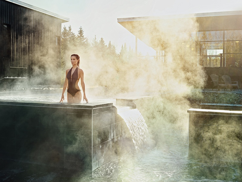 Soothe aching muscles after a day on the slopes in the steam baths, hot tubs, and Finnish saunas at Station Blü Nordic Spa.