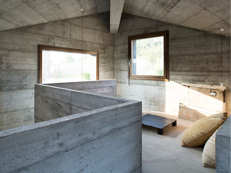 When concrete is paired with bespoke timber joinery, the results can be spectacular. The interior of House R in Italy by 35a Studio shows that there isn't much needed beyond a considered concrete structure and a sparse edit of well-made furniture. Photograph: Architects Andrea Carmignola and Maddalena Merlo