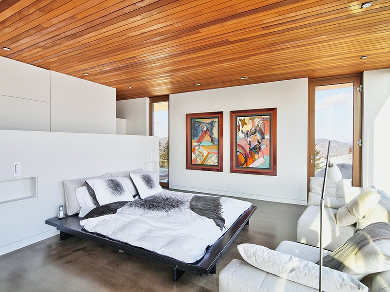 Underfloor heating in the master suite, and throughout the property, warms the house against the freezing outside temperatures. Photograph: Alexandre Guilbeault