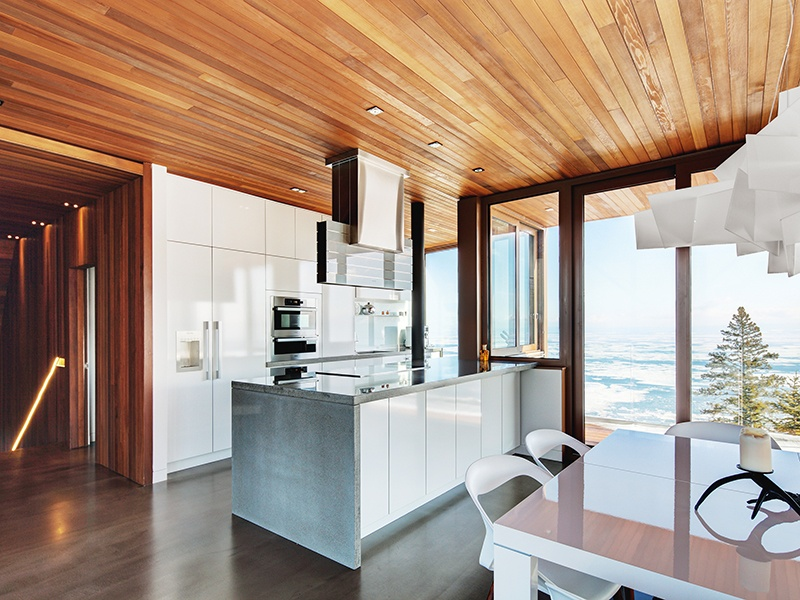 """Thanks to a clever """"pass"""" window, the kitchen allows for indoor–outdoor dining. Photograph: Alexandre Guilbeault"""
