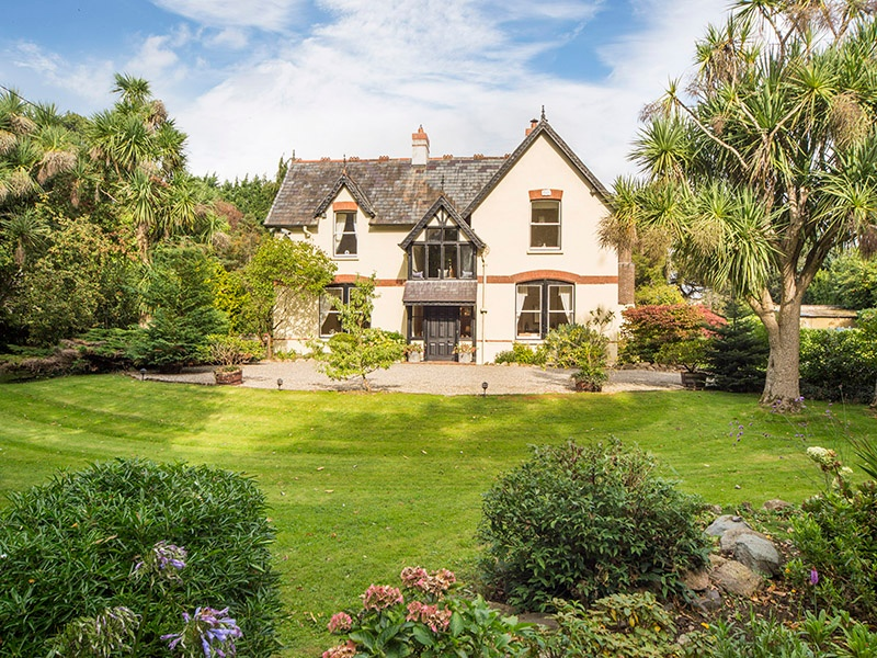 A charming five-bedroom Victorian family home with original sash windows and marble fireplaces, The Old Rectory is set within four acres of beautiful gardens.