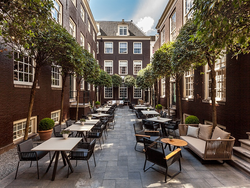 Once the site of a famous theater, The Dylan hotel blends historic 17th-century architecture with contemporary interiors and Michelin-starred dining.