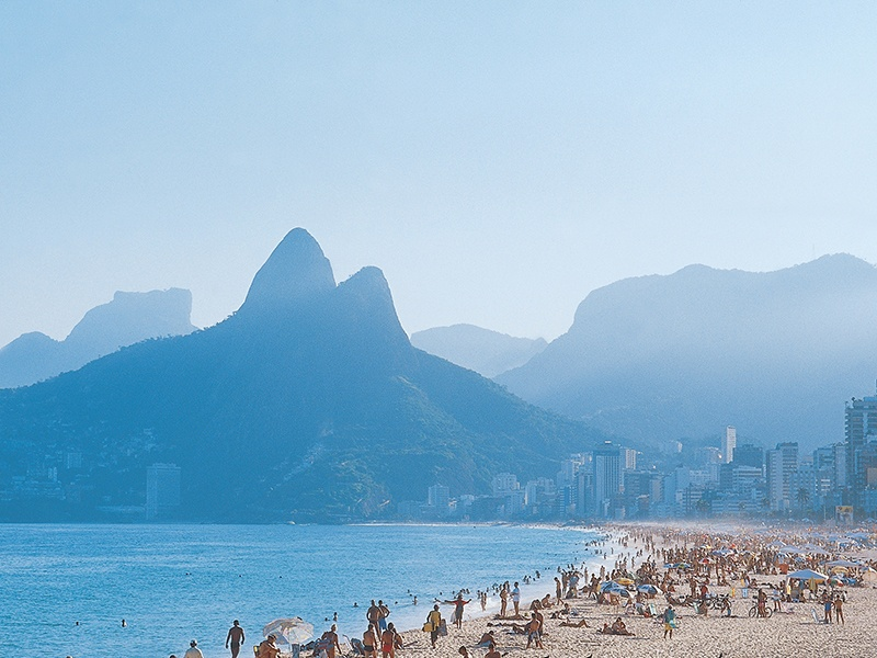 The world-famous Copacabana Beach in Rio de Janeiro, looking towards Sugarloaf Mountain—whose 1,300-foot peak is served by a cable car from Praia Vermelha. Photograph: Abercrombie & Kent