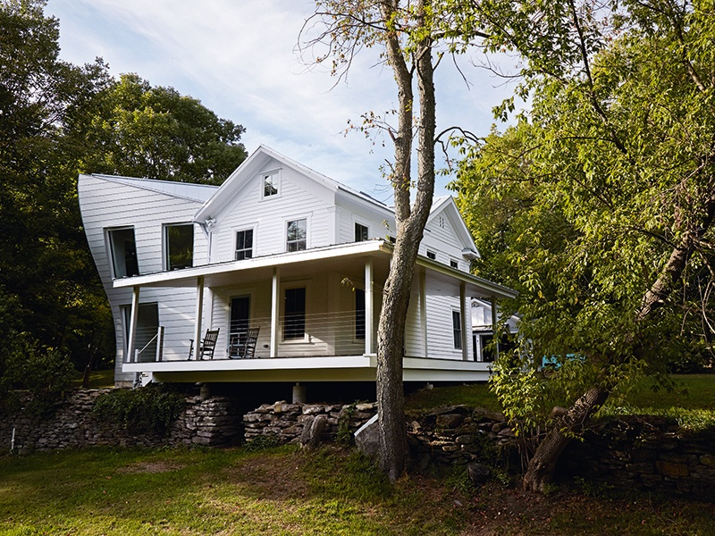 """The Twist Farmhouse in rural Pennsylvania is a sculptural expression of family connection—the client's family lived across the street and Tom Givone imagined the familial bond as a gravitational field, """"pulling"""" the new home towards the old. Photograph: Christopher Testani. Banner image: Mark Mahaney"""