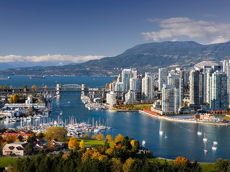 Tucked up against the waterfront of Vancouver, the Coal Harbour neighborhood features luxury housing as well as a busy working harbor. Photograph: Getty Images
