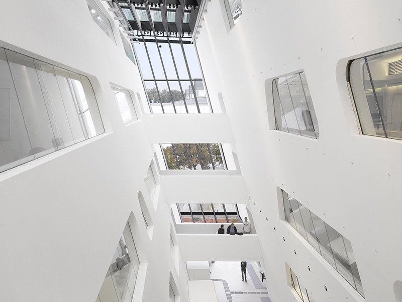 While the exterior edges of Zaha Hadid's library at the University of Economics Vienna are cut sharply, the interior spaces join together in a flowing free-form. Photograph: Roland Halbe