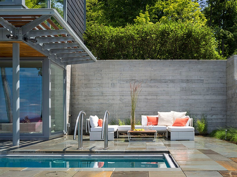 Wagner Hodgson has found that clients desire multipurpose outdoor pools; the firm uses lighting and fountains to make the pool a design element. Photograph: Westphalen