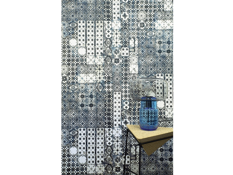 Resembling hand-painted tiles, the Porto wallcovering design by Jean Paul Gaultier for Lelièvre is produced in three colorways: Ciel (pictured), Mandarine, and Laque. Photography: www.lelievre.eu
