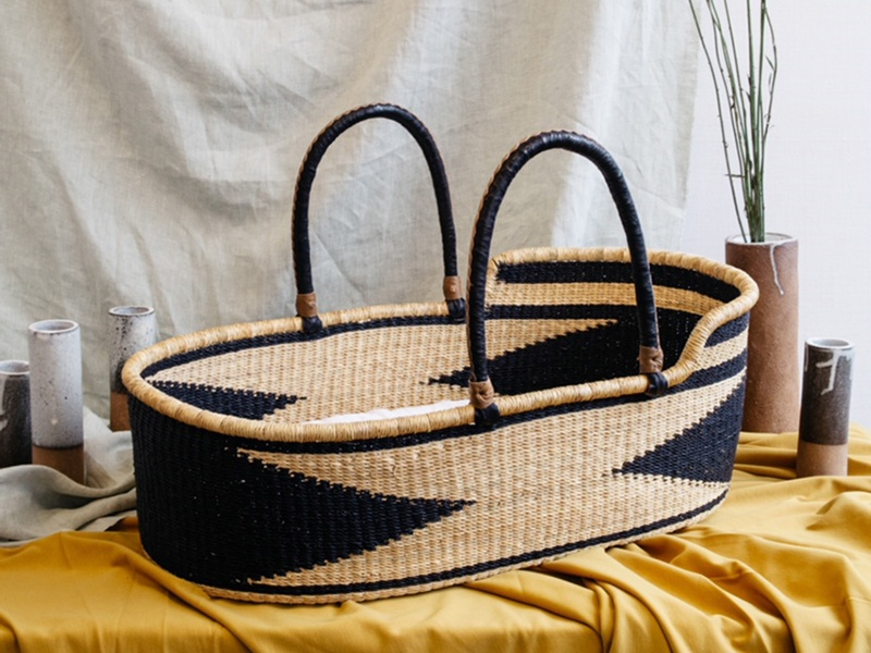 Woven from elephant grass, and colored with non-toxic dyes, each Moses basket from The Wanderer comes with a custom-made mattress for a newborn, and can be reused as a functional design piece as the baby outgrows it.